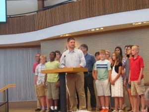 Pastor Daniel Yoder with the Genesis youth group who summarized the Bible in one hundred words