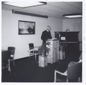 J. Irvin preaching in the Menno Haven Chapel Service